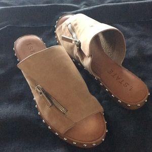 Open toe slide sandals.